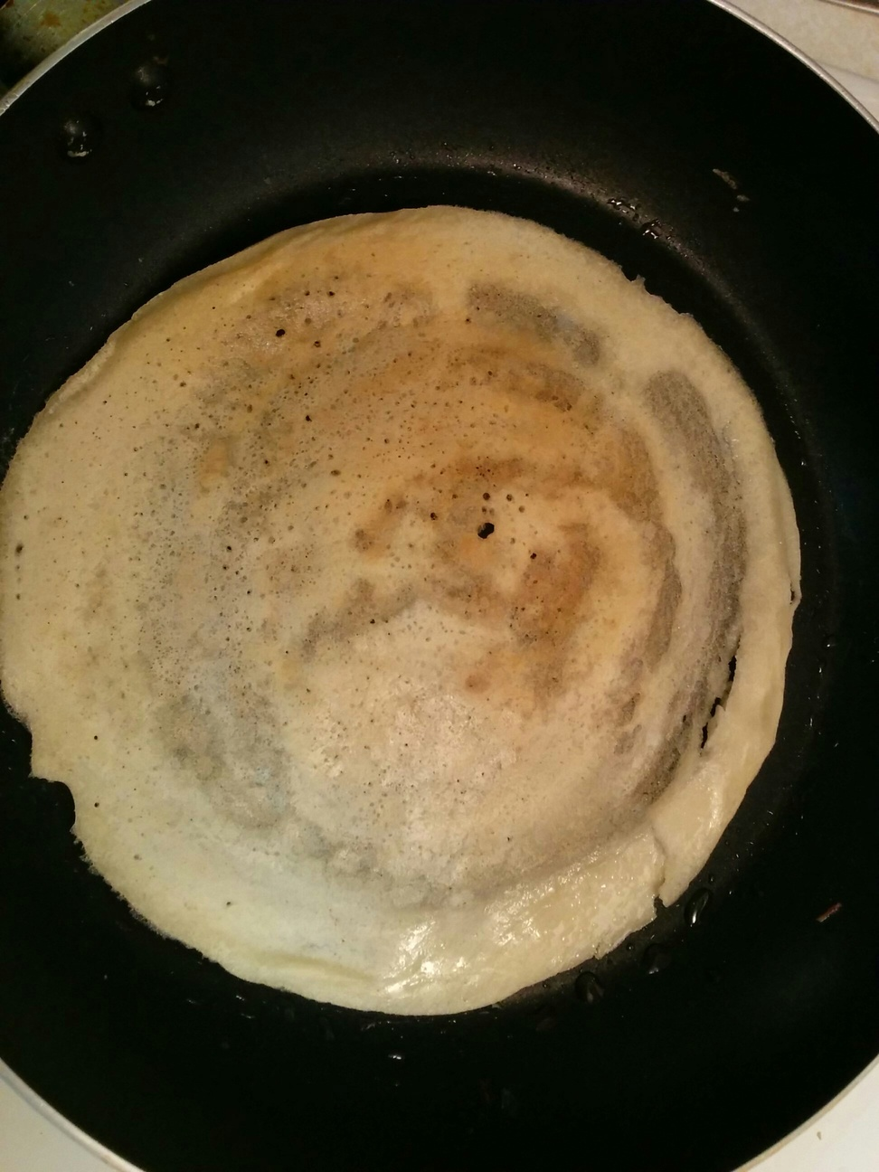 Dosa making on a pan